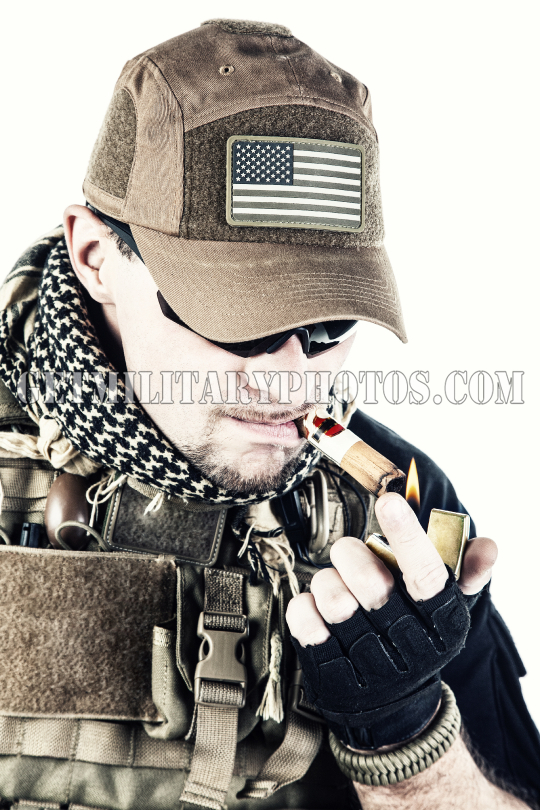 PMC contractor smoking a cigar
