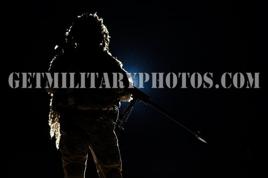 Army sniper with huge rifle
