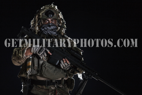 Army sniper with painted face