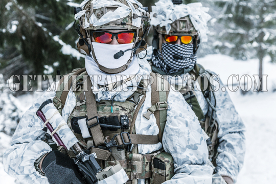 Soldiers in winter forest