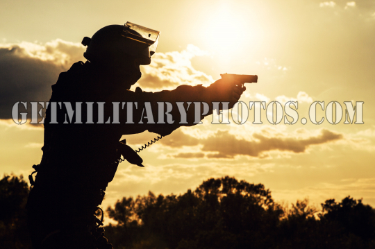 police officer with pistol