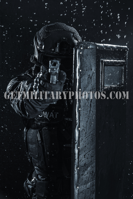 police officer with ballistic shield