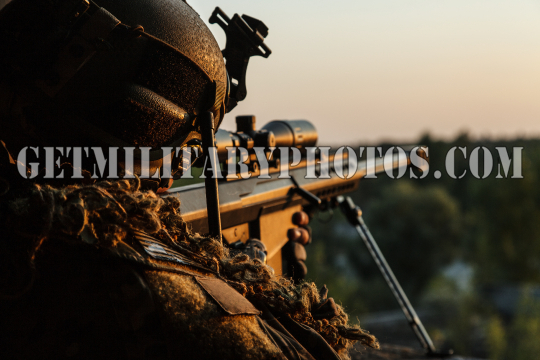 Army sniper with large caliber rifle