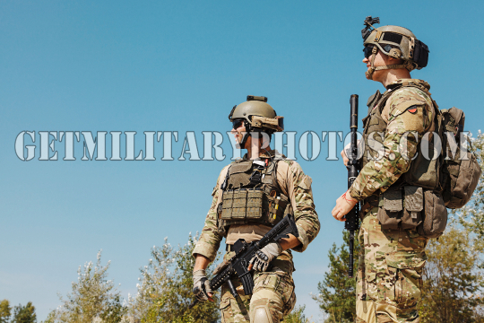US Army Rangers with weapons in the desert.