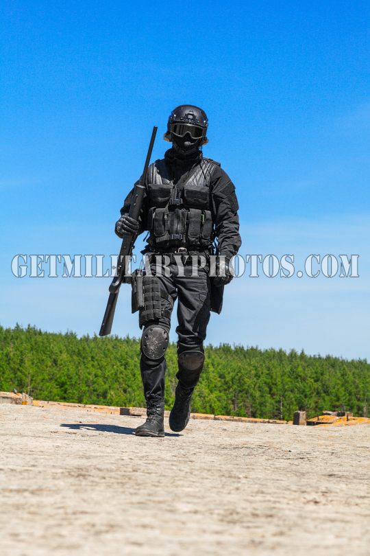 swat police operator with sniper rifle